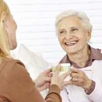 Caregiver giving coffee